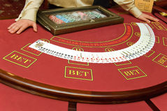 Cards game. Cards are on red table in casino Royalty Free Stock Photography