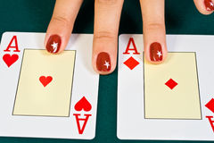 Cards in the hand. Cards for the poker on the table royalty free stock photography