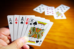 Cards Hand. A good set of playing cards in the had of the gambler Royalty Free Stock Images