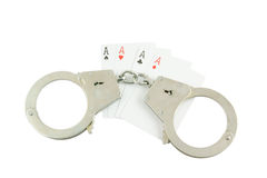 Cards and handcuffs isolated Royalty Free Stock Photos