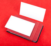 Cards holder and  blank business cards. Red leather business cards holder and  blank business cards on red background Royalty Free Stock Image