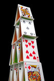 Cards house on black. House of cards isolated on a black background Stock Photo