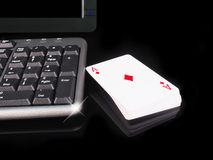 Cards beside the keyboard. online card games concept Stock Image