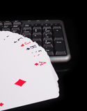 Cards beside the keyboard. online card games concept Royalty Free Stock Photos
