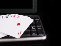 Cards beside the keyboard. online card games concept Royalty Free Stock Photo