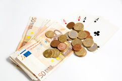 Cards and money. Four aces, coins and banknotes (euros Stock Photos
