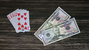 Cards and money. On a wooden background Stock Images
