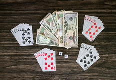 Cards and money. On a wooden background Royalty Free Stock Images