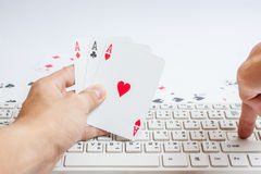 Cards over computer keyboard and smartphone. Concept of online c Royalty Free Stock Photos