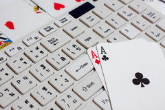Cards over computer keyboard and smartphone. Concept of online c Royalty Free Stock Photography