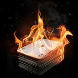 Cards package in Fire. Royalty Free Stock Photos