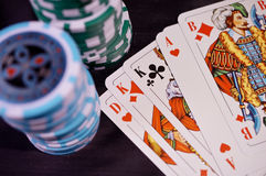 Cards and poker chips. Poker cards and chips on a table Stock Image