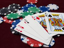 Cards and poker chips on a red background. stock photography