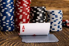 Cards and poker chips, on a wooden background royalty free stock photos