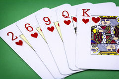 Cards poker deck English, Poker hand call color, consisting of five letters of hearts, two of hearts, six of hearts, nine of heart Royalty Free Stock Photo
