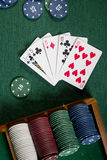 Cards with poker hand with chips Stock Images