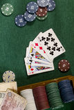 Cards with poker hand with chips and money Stock Photography