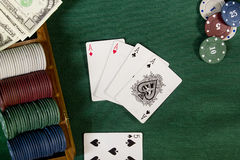 Cards with poker hand with chips and money Royalty Free Stock Photo