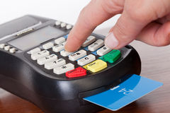 Cards servicing with POS-terminal Stock Image