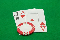 Cards showing pair of aces with chip on green Royalty Free Stock Photos