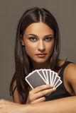 Cards and smile. Beautiful attractive girl holding poker cards Stock Photos