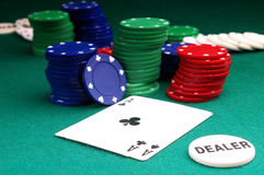 Cards and  stack of Poker chips. Nd   and dealer button on a green background Stock Image