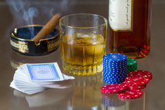 Cards, tokens, whiskey and cigar Royalty Free Stock Photography