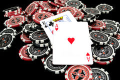 Cards and ultimate poker chips. On black Royalty Free Stock Image