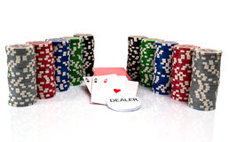 Cards and ultimate poker chips on white Royalty Free Stock Photos