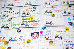 Cards on the wall made by tourists  with regards to the guests and the organizers of the Olympic Winter Games 2018. GANGNEUNG, SOUTH KOREA - JANUARY, 2017: Cards Royalty Free Stock Image