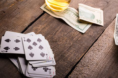 Cards, whisky and money Stock Photos