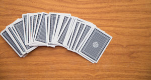 Cards on the wooden table Royalty Free Stock Image