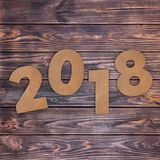 Cardstock Numbers 2018 Happy New Year Sign over table. 3d Render Stock Photos