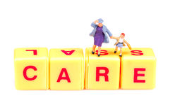 Care. Written on yellow blocks Royalty Free Stock Image