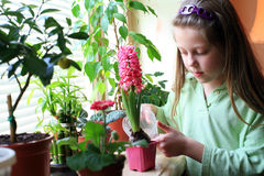 Care. An image of a girl taking care of her flowers Stock Photo