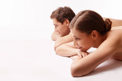 Care. Young couple naked on a white background Royalty Free Stock Photo