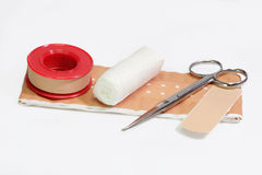 Care. First aid kit and bandage on a bright background Royalty Free Stock Image