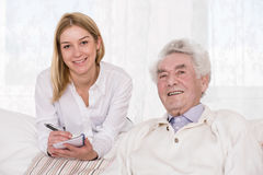 Care assistant and elder man Stock Image