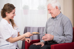 Care assistant and retired man Stock Photography