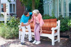 Care assistant tending to a senior lady. Stock Image