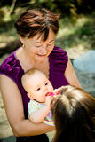 Care for bay - feeding Stock Images