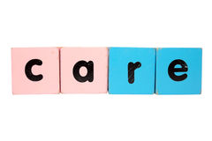 Care in block letters with clipping path Royalty Free Stock Image