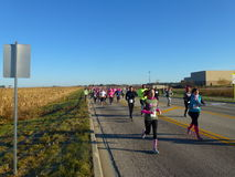 2015 Care4Cancer 5K Run/Walk. October 18, 2015 Care4Breast Cancer Run starting at Woodstock High School (in background). Throng of runners at outset of 15th Stock Photography
