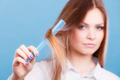 Girl with comb. Stock Photography