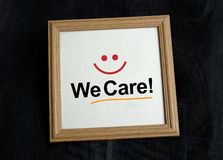 We Care - Customer Service Sign with smile in photo frame.  Stock Images