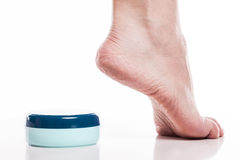 Care for dry skin on the well-groomed feet and heels with creams Royalty Free Stock Photos