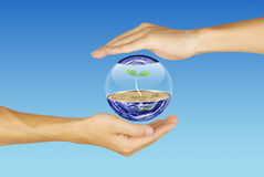 Care for the earth. Earth and the hand Royalty Free Stock Images