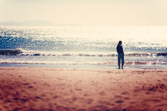 Care free woman taking a walk before sunset on the Essaouira beach Stock Image