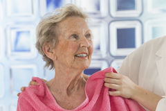 Care giver or nurse assisting elderly woman for shower. Care giver or nurse givng assistance to elderly woman for shower Stock Photography