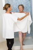 Care giver or nurse  assisting elderly woman for shower Royalty Free Stock Photo